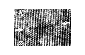 A superconducting multifilament wire made of Nb-Ti alloy was investigated by methods of atom probe/field ion microscopy, three-dimensional atom probe, high resolution electron microscopy (HREM) and computer simulation. Figure shows a HREM micrograph of the coherent interphase boundary with an ideal conjugation of atomic planes of adjacent grains.